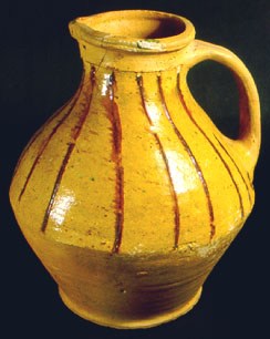 Biconical jug with strap handle