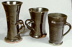 Blackware flared mugs with vertical loop handles