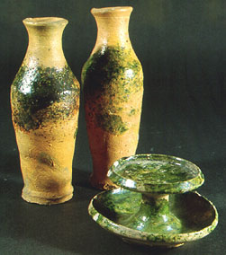 Wheel-thrown biconical bottles and a saucer lamp